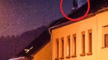 Flüchtling will von Dach springen